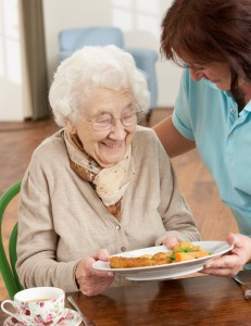 stock-photo-16275210-senior-woman-being-served-meal-by-carer